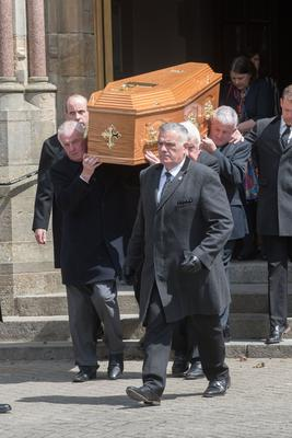 The bishop's coffin is carried