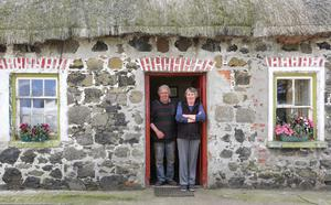 Edward and Ellen at the door of their 300-year-old home