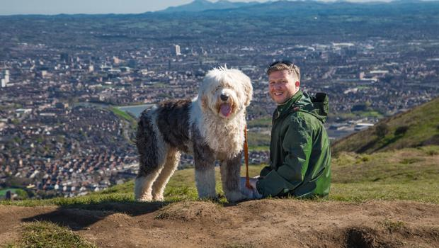 Belfast man Michael Conlon, who will represent Northern Ireland in The Big Walk, out on a training session with his dog Louie on Cave Hill