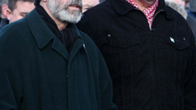 President of Sinn Fein Gerry Adams is flanked by Bobby Storey at a funeral in west Belfast in March 2008