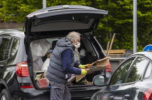 A man dropping off cardboard at Blackstaff Way Recycling Centre in west Belfast (Liam McBurney/PA)