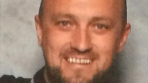 Ryan Baird died after the Rangers supporters' club bus he was travelling on crashed at Crossroads roundabout on the A76 near to Kilmarnock on Saturday (PA/Police Scotland)
