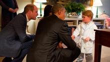 The Duke of Cambridge and President Obama chat with Prince George in his pyjamas and dressing gown