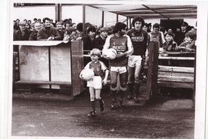 George Best leading the teams out with mascot