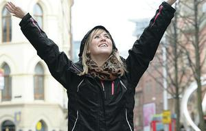 Kate Crowe from Holywood pictured in Belfast City Centre as strong wind and rain are to hit Northern Ireland.