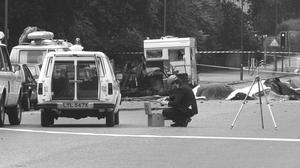 A police photographer at the scene of the Hyde Park bombing in 1982