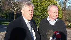 Democratic Unionist First Minister Peter Robinson and Sinn Fein Deputy First Minister Martin McGuinness outside Stormont Castle in Belfast, as they have said progress has been made to resolve a destabilising row over welfare reform
