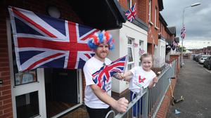 Connor Corry and his daughter Eden Corry, six, take part in one of many socially distanced street parties around Belfast's Shankill Road to mark the 75th anniversary of VE Day.