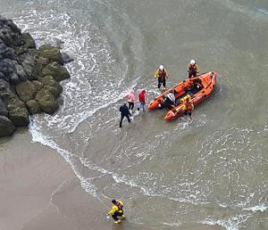 Rescue teams at the scene after a family was cut off by the tide on cliffs between Castlerock and Downhill beaches yesterday
