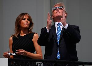 Donald and Melania Trump watch the eclipse from the White House