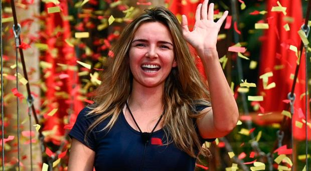 Nadine waves as she leaves the jungle camp
