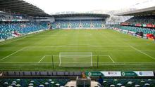 The Irish FA, based at Windsor Park, has adopted a FIFA ruling on transfers seven months after it was recommended.