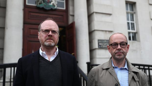 Journalists Trevor Birney, left, Barry McCaffrey outside the Royal Courts of Justice in Belfast (Brian Lawless/PA)