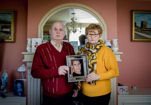 Memories: Breege and Stephen Quinn with a treasured photo of their murdered son Paul