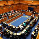 Northern Ireland's 90 MLAs returned to work after a three-year break.