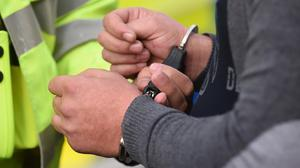 A 14-year-old's father alleged she was left in a distressed state after he was apprehended for suspected firearms offences