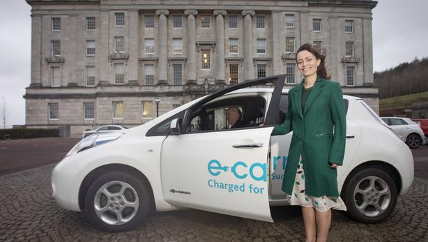 Infrastructure Minister Nichola Mallon at Stormont with her electric car