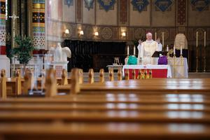 Bishop of Down and Connor Noel Treanor officiates at the Mass of Chrism in an empty St Peter's Cathedral in west Belfast