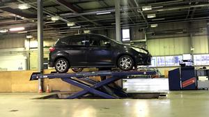 A car on a lift at a MoT test centre in Northern Ireland