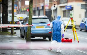 A forensics officer at the scene of the hit-and-run on the Springfield Road