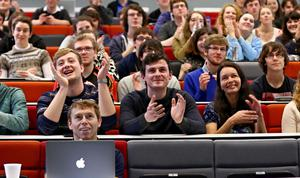 Students in the Physics department of Queens University in Belfast celebrating as the comet lands successfully