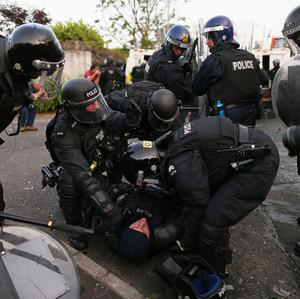 A total of 32 police officers were injured in violence in Belfast on Friday