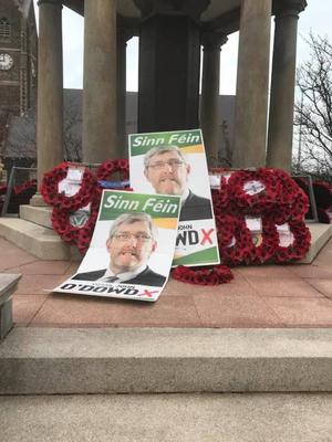 The Sinn Fein posters on top of the poppy display