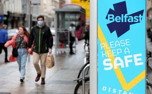 Precautions: shoppers in Belfast City Centre at the weekend