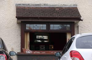A window was smashed and paint thrown around the inside of a Coleraine home in an attack police are treating as a hate crime