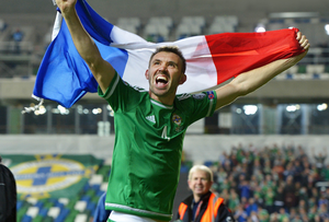 Northern Ireland's Gareth McAuley celebrates clinching qualification for Euro 2016.  (Photo by Charles McQuillan/Getty Images)