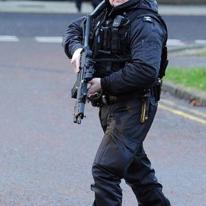 Police responding to an incident in Belfast have fired a gun