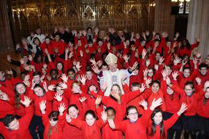 Archbishop Eamon Martin joins the choir of Saint Joseph's National School Dundalk in St Patrick's Cathedral , Armagh, yesterday