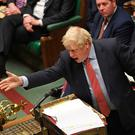 Boris Johnson speaks in the House of Commons at Westminster yesterday