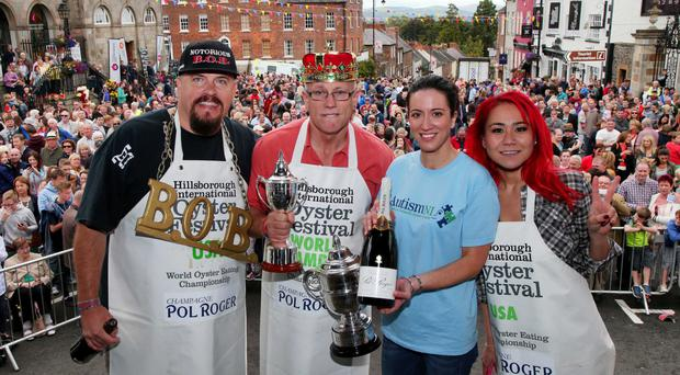 Dromore's Colin Shirlow (second left) celebrates winning the world oyster eating championship at the Hillsborough International Oyster Festival in 2014