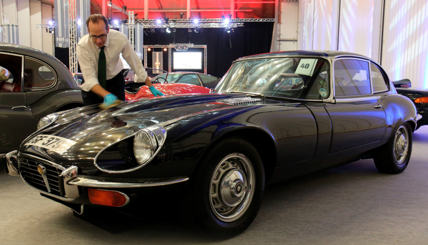 H&H auctioneer James Wheeler polishes up the Jaguar once owned by George Best