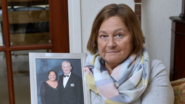 Barbara Robinson with a picture of her late husband, retired PSNI Chief Superintendent Robbie Robinson