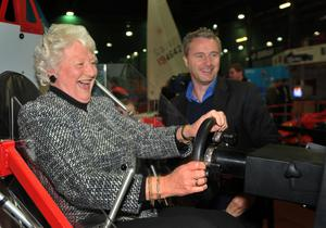 Sporting heroes: Olympic Gold Medallist Lady Mary Peters gets a lesson on the Formula One simulator from Eddie Irivine at an event to promote the Ulster Sports Museum in Bangor in 2010