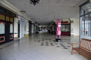 The echoing mall empty of people