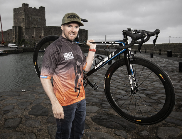 NW200 legend Alastair Seeley in the official 2019 Giant's Causeway Coast Sportive jersey at Carrickfergus Castle