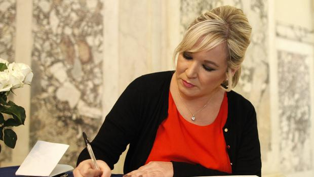 Michelle O'Neill signs book of condolence at Belfast City Hall