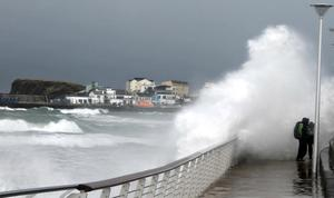 Waves crash into the harbour wall at Portrush