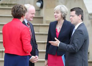 PM Theresa May with First Minister Arlene Foster, Deputy First Minister Martin McGuinness and James Brokenshire at Stormont