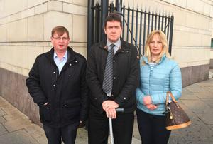 Willie Frazer with Colin and Barbara Worton outside Laganside Court in Belfast