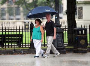 Dodging the drizzle in soggy Belfast yesterday evening