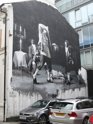 The murals on the walls beside the Black Box in Hill Street