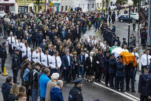 The streets of Charlestown in Co Mayo were packed for the funeral of Detective Garda Colm Horkan