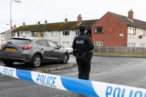 Police at the scene in the Woodburn area of Carrickfergus after Glenn Quinn was murdered earlier this year