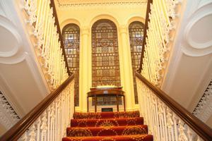 The ornate central staircase, said to have inspired the stairway in the Titanic