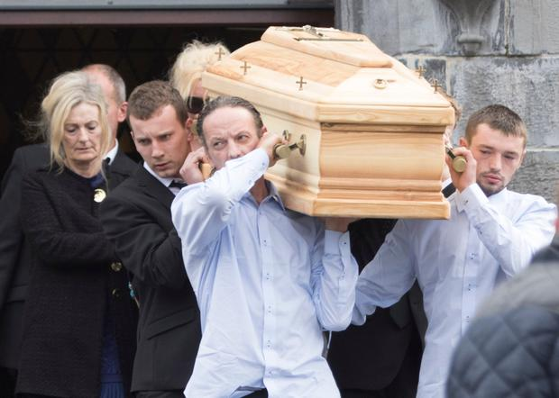 The remains of 20-year-old Shiva Devine are carried from St Brigid's Church in Ballintra. Shiva died in a car crash in Bundoran at the weekend