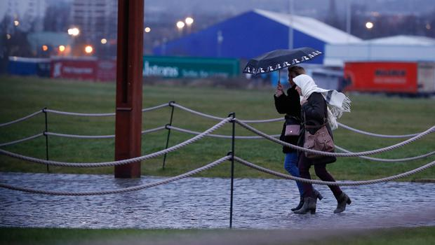 Walkers battle with wind and rain in Belfast during Storm Ciara